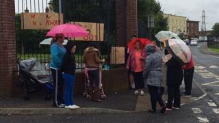 Protesters placed banners on the school gates on the last day of term