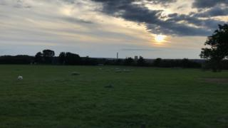 From Little Wittenham overlooking Didcot power station in Oxfordshire with the sun setting