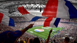 Fans wave French flags in Russia