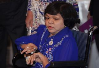 ET, Myanmar's most famous fortune teller, sits on a wheelchair as she attends a local television program in Bangkok on 23 July 2012.