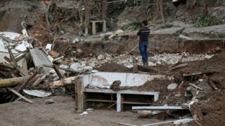 A man looks at a destroyed area after flooding and mudslides caused by heavy rains in Mocoa