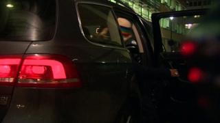 Passenger getting into private hire vehicle