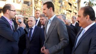 Президент Сирии Башар Асад (в центре)