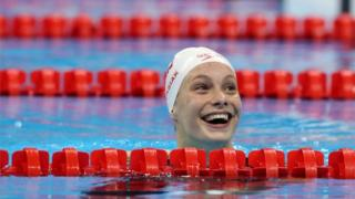 Canada's Penny Oleksiak tied to win the gold medal, setting a new Olympic record in the women's 100-meter freestyle at the 2016 Summer Olympics.