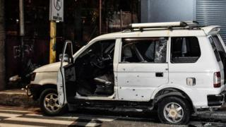 Vehicle with bullet holes