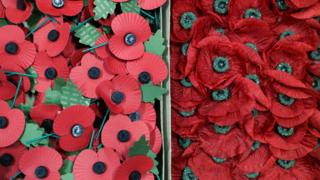 A box of present day poppies (left) next to a box of poppies, which are believed to date back to before the Second World War, which were found in an old suitcase in Cardiff a week before Armistice day