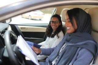 Student Maria al-Faraj with driving instructor Ahlam al-Somali