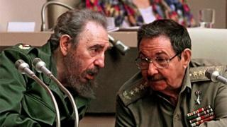 In this file picture taken on December 20, 1999 Cuban President Fidel Castro (L) confers with his brother Raul Castro, Minister of the Cuban Armed Forces, during a session of the Cuban National Assembly, in Havana