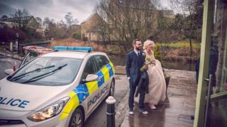 Bride and Groom escorted by police
