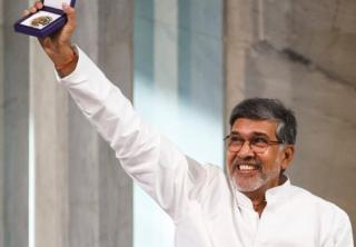 In this picture from 10 December 2014, Nobel Peace Prize joint-winner Kailash Satyarthi of India holds up his Nobel Peace Prize medal during the Nobel Peace Prize award ceremony in Oslo, Norway