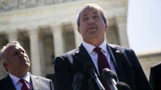 Texas Attorney General Ken Paxton speaks to reporters outside the Supreme Court on June 9, 2016