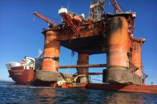 The rig is out of water on the deck of the transport ship, Hawk