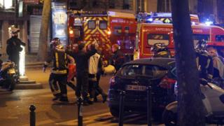 Medics move a wounded man near the Boulevard des Filles-du-Calvaire after an attack November 13, 2015 in Paris