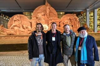 Sand sculptors Radovan Zivny, Susanne Ruseler, Ilya Filimontsev and Rich Varano pose in front of the nativity scene as the artwork is inaugurated at St Peter's Square in Vatican City, 7 December 2018