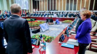 German Chancellor Angela Merkel (R) next to French Foreign Minister Jean-Marc Ayrault (L), along with other attendees, observe a moment of silence for the victims of the recent attack in Nice, France, at the beginning of the Asia-Europe Meeting (ASEM) Summit in Ulan Bator, Mongolia, 15 July 2016.