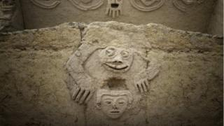 An undated handout photo made available by Archaeological Area Caral shows a humanized toad and an anthropomorphic head, discovered in one of the buildings of the civilization of Caral, north of Lima