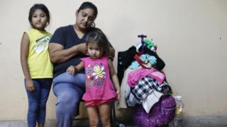 Migrant mother poses with children in a shelter in Tijuana, Mexico - 20 June
