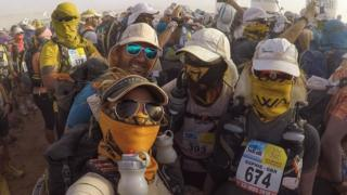 Sophie Raworth during a sandstorm on the final day of the the Marathon des Sables