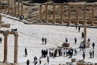 Prince William and Crown Prince Hussein walk at the ancient city of Jerash