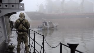 A Ukrainian soldier mans the machine-gun of a vessel on the Azov Sea on November 28, 2018 in Mariupol, Ukraine