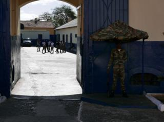 Soldier standing guard outside the main army garrison in Praia.