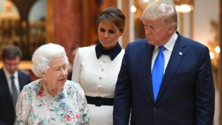 Queen Elizabeth shows Mr Trump and the First Lady items on display