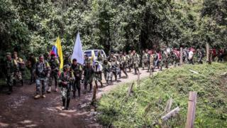 FARC guerrillas column arriving to hand on their weapons in Buenos Aires, Cauca department, Colombia on January 1, 2017.