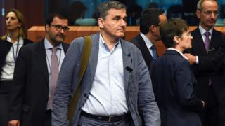 Greek Finance Minister Euclid Tsakalotos arrives for a Eurogroup meeting at the European Union headquarters in Brussels on May 24, 2016