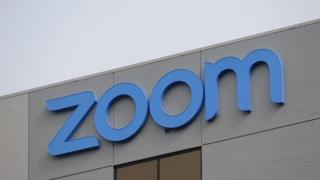 The Zoom logo is seen on the side of a building