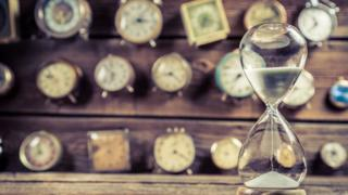 Clocks and an hourglass