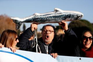 "Men take part in the ""Sardine Movement"" rally in Rome, 14 December"
