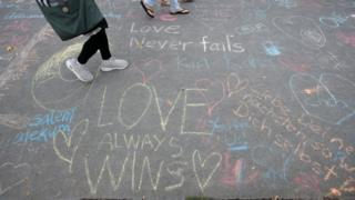 chalk messages of support for victims of terror attack