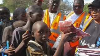 Aid distribution at camp for displaced people in Nigeria