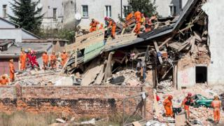 Polish emergency staff and firefighters work at the scene of a gas explosion that caused a tenement building to collapse in Swiebodzice, southwestern Poland, 08 April 2017