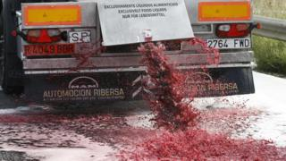 Wine flows from the tap of a Spanish lorry