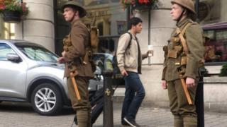 Soldiers appear in Belfast near the Europa Hotel