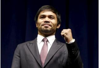"""Eight-division world champion Manny """"Pac-Man"""" Pacquiao attends a news conference ahead of his upcoming bout with five-division world boxing champion Floyd """"Money"""" Mayweather (not seen), in Los Angeles, California in this 11 March 2015 file photo"""