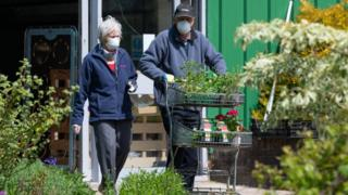 Couple in masks at garden centre