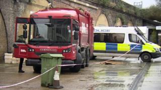 Bin lorry and police van