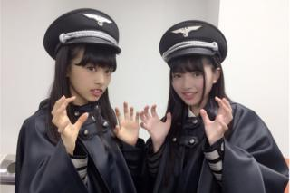 Two members of Keyakizaka46, posing in the costumes