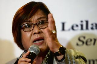 Former justice secretary and human rights chief Senator Leila de Lima gestures during a press conference in Manila on 7 November 2016 after filing her petition for habeas data against Philippine President Rodrigo Duterte.