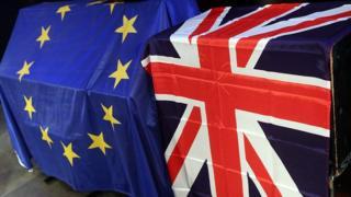 An EU flag and a UK union flag