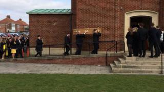 Charlie Pope's coffin being carried into church