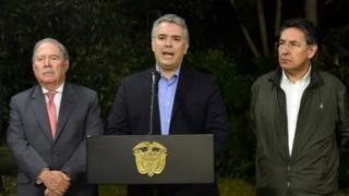 Colombian President Ivan Duque (C) speaks next to Colombian Defense Minister Guillermo Botero (L) and Colombian Attorney General Nestor Humberto Martinez (R)