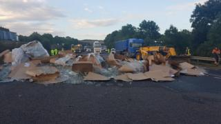 Glass and debris from the overturned lorry