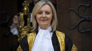 Liz Truss wearing official robes outside the Royal Courts of Justice