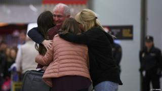 Former mayor of Caracas, Antonio Ledezma (2L) meets his wife Mitzy Capriles (C) and daughters at his arrival to Adolfo Suarez Madrid Barajas Airport on November 18, 2017 in Madrid, Spain.