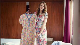 Woman wearing floral print Cath Kidston dress