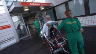 Patient being wheeled into A&E by paramedics