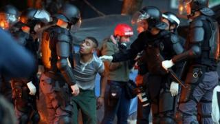 Riot police carry out an operation in a neighbourhood known to locals as Cracolandia (Crackland), in downtown Sao Paulo, Brazil June 11,